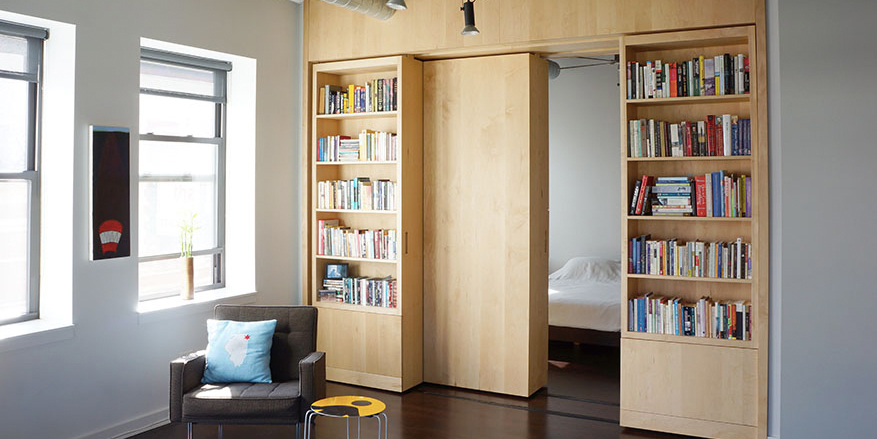 built in sliding bookshelves
