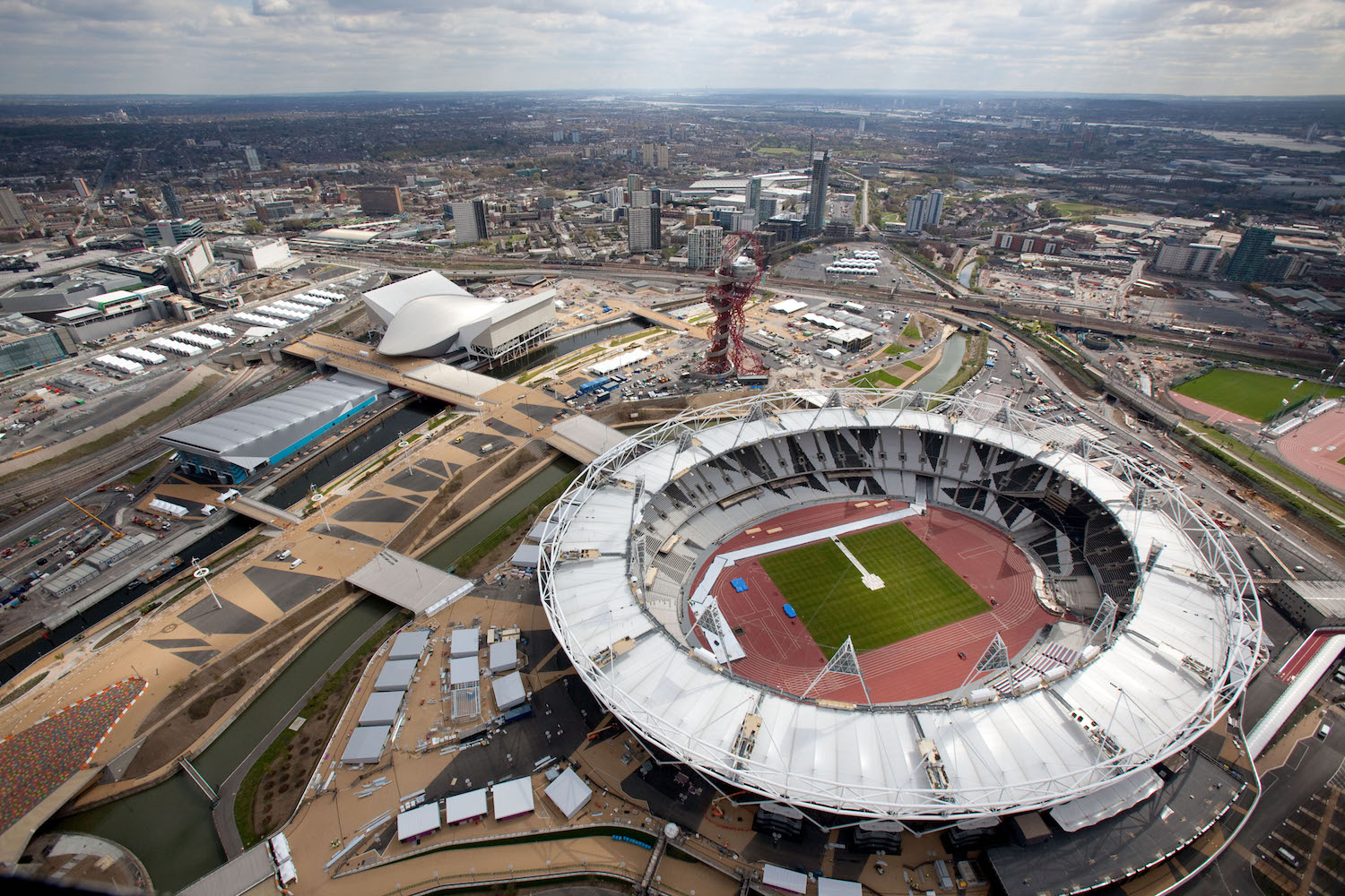 Aerial view of the Olympic Park showing the Olympic Stadium the Aquatics Centre and Water Polo Arena to the left.