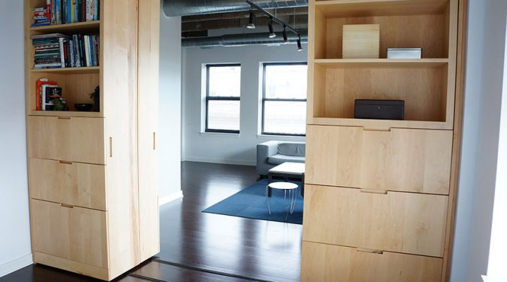 Picture of modular drawers on a track slid open so you can see the living room behind them