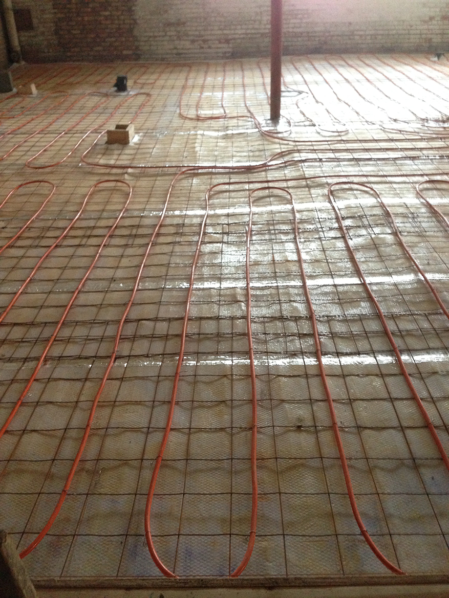 radiant floor heating in mixed use retail and apartment