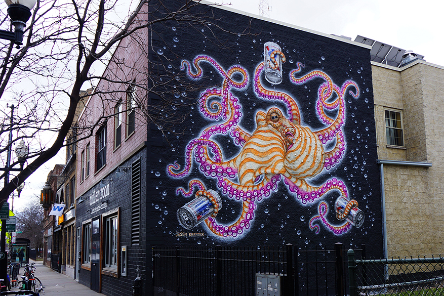 Part of Logan Square Public Art, Jason Brammers giant octopus mural holding cans of PBR